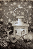 Christmas vintage lantern in snowy night in sepia Royalty Free Stock Image