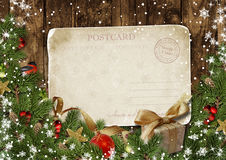 Christmas vintage postcard with decor on wood Stock Photos