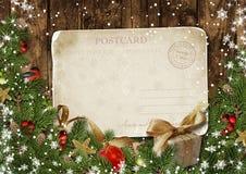 Christmas vintage postcard with decor on wood Stock Photos
