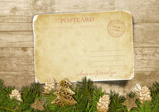 Christmas vintage postcard  with fir-tree with  cones over wood Royalty Free Stock Photo