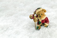 Christmas Vintage Teddy Bear in Snow. Christmas vintage teddy bear decoration against a snow backdrop with copy space Stock Image