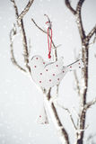 Christmas Vintage Toy Bird on a Silver Branch Stock Photography