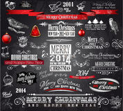 2014 Christmas Vintage typograph design elements:. Vintage labels. ribbons, stickers, baubles and gift boxes, birds, liquid drops, swirls and so on Stock Photos