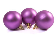 Christmas violet spheres. Three christmas spheres on a white background Stock Images