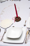 Christmas wafer. Traditional Christmas wafer on white linen tablecloth. Xmas table setting Royalty Free Stock Photos