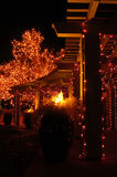 Christmas Walk. A covered walkway is lit with colorful Christmas lights Stock Images
