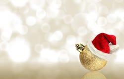 Christmas wallpaper. Christmas ball with santa hat Stock Photos