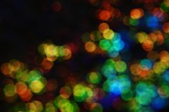 Christmas wallpaper decorations concept. Background of colorful bulb lights. Defocused and abstract colourful bokeh with night light. Holiday festival backdrop royalty free stock photography