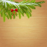Christmas Wallpaper with spruce branches on the background of wo. Oden boards  For use as logos on cards, in printing, posters, invitations, web design and other Royalty Free Stock Photo