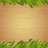 Christmas Wallpaper with spruce branches on the background  Royalty Free Stock Photo