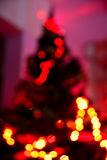Christmas warm blurred night background. Elegant fir in the living room Stock Photo