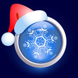 Christmas web button and santa cap. Christmas web button with  snowflake and santa cap Stock Photography