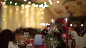Christmas wedding banquet hall interior details with decorand table setting at restaurant. Winter season decoration of. Christmas or New Year wedding banquet stock video footage