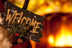 Christmas Welcome Sign. Besides a Fireplace stock images