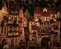Christmas Whimsical Decoration. A whimsical Christmas decoration representing a medieval villag of animals royalty free stock images