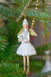 Christmas. White angel on the Christmas tree royalty free stock photography