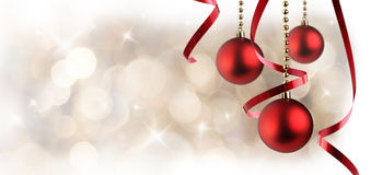 Christmas white background with red balls and ribbon hanging hor Royalty Free Stock Image