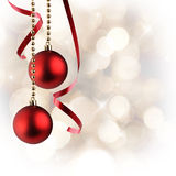 Christmas white background with red balls and ribbon hanging squ Royalty Free Stock Photos
