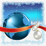 Christmas white balls with globe on blue Stock Photos