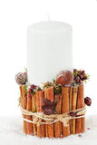 Christmas white candle in a candlestick with cinnamon Royalty Free Stock Photography