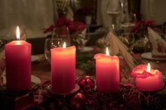 Christmas white candles 4 red,isolated black background stock images