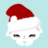 Christmas white fluffy cute bunny. Childrens character. New Year poster. Pet in a Santa Claus hat. Stock Photo
