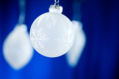 Christmas: White Frosty Ornaments On Blue Background Stock Photo