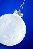 Christmas: White Frosty Ornaments On Blue Background Stock Images