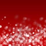Christmas white lights. White lights over dark red background Stock Photo