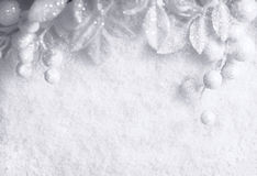 Christmas white seasonal background. With snow, beads and tinsel Stock Image