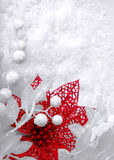 Christmas white seasonal background. With snow, beads and red tinsel Royalty Free Stock Photos