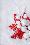 Christmas white seasonal background. With snow, beads and red tinsel Stock Photo