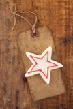 Christmas white star candy on retro paper tag Stock Photo