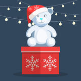 Christmas white Teddy bear. Sitting on gift box with snowflake and lights on the background. Vector illustration of a trendy style cartoon template for you web Royalty Free Stock Photo