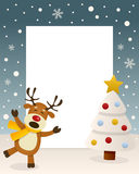 Christmas White Tree Frame & Reindeer. Christmas vertical photo frame with a Christmas tree and a happy reindeer singing in a snowy scene. Eps file available Royalty Free Stock Photo