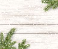 Christmas white wooden background with holiday fir tree, branches and falling shiny snow. View with copy space. Vector illustration Royalty Free Stock Photography