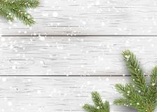Christmas white wooden background with holiday fir tree branches, pine cone and falling shiny snow. Flat lay, Top view with copy s. Pace for your text. Vector Royalty Free Stock Image
