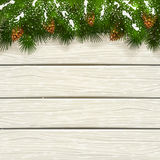 Christmas white wooden background with snow on fir tree branches. Winter theme, Christmas decorations with pinecone, decorative spruce branches with pine cones Royalty Free Stock Photo
