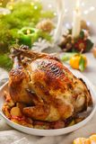 Christmas whole roast chicken with tangerines, apples and thyme royalty free stock images