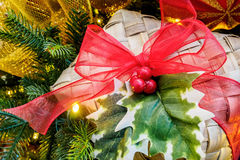 Christmas wicker box, red ribbon and holly Royalty Free Stock Images