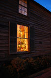 Christmas window. Photo of window with Christmas decorations at night Royalty Free Stock Image