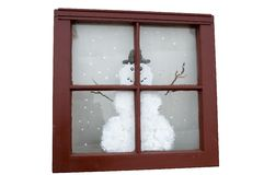 Christmas window. Antique window from old house with a snowman painted on it Stock Photography