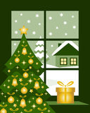 Christmas window. Christmas tree and gift at window Royalty Free Stock Photography