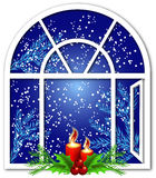 Christmas window with candles. And snow Royalty Free Stock Photography