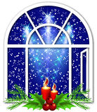 Christmas window with candles Royalty Free Stock Images