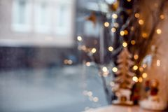Christmas window decor with golden lights and tree in bokeh. Holiday atmosphere stock image
