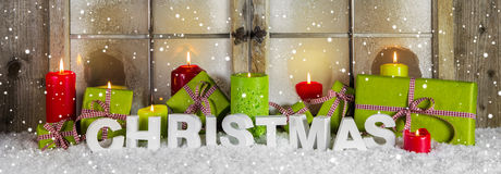 Christmas window decoration for advertising or sales in red and Royalty Free Stock Images