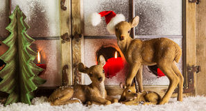 Free Christmas Window Decoration: Deer Family With Red Candles. Stock Images - 44098944