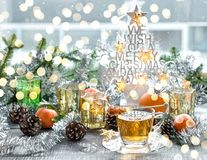 Christmas window decoration golden lights tea. Christmas window decoration with golden lights and cup of tea Royalty Free Stock Images