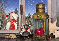 Christmas window decoration with old toys and a lantern with a r Royalty Free Stock Image